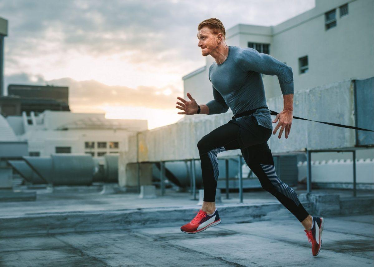 Man exercising through resistance training